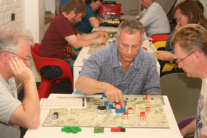 Carl, Keith, and Scott thinking and making manuevers while playing Napoleon by Columbia Games